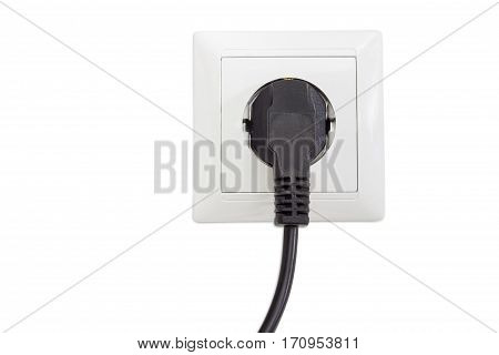 White socket outlet European standard with connected corresponding black AC power plug closeup on a light background