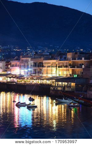 HERSONISSOS, CRETE - SEPTEMBER 18, 2016 - View of harbour and waterfront restaurants at dusk Hersonissos Crete Greece Europe, September 18, 2016.