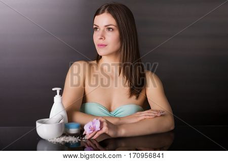 Woman With A Skincare Products