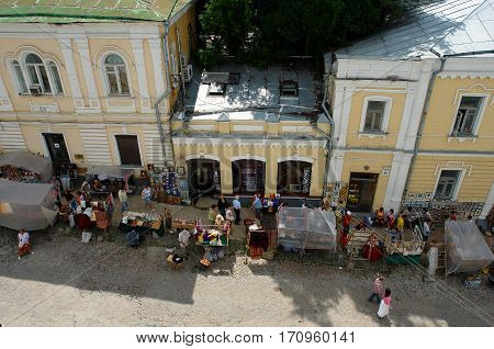 Kiev Ukraine - June 28 2008: Tourists visiting the trays with articles of folk artists on the street St. Andrew's Descent top view.