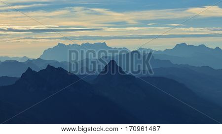 Outlines of mount Mythen and other mountains. Early morning in the Swiss Alps. View from mount Rigi.