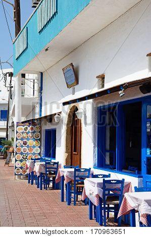 IERAPETRA, CRETE - SEPTEMBER 18, 2016 - Blue tables and chairs outside a cafe Ierapetra Crete Greece Europe, September 18, 2016.