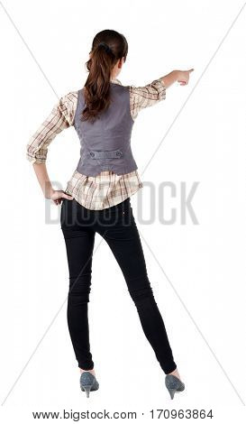 woman pointing. Back view . beautiful brunette girl in shirt gesture.  Rear view people collection.  backside view of person.  Isolated over white background.