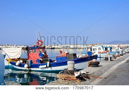IERAPETRA, CRETE - SEPTEMBER 18, 2016 - Traditional fishing boats moored in the harbour Ierapetra Crete Greece Europe, September 18, 2016.