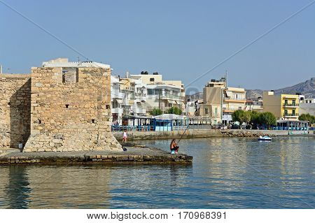 IERAPETRA, CRETE - SEPTEMBER 18, 2016 - Corner of Kales Venetian fortress at the harbour entrance with views along the waterfront Ierapetra Crete Greece Europe, September 18, 2016.