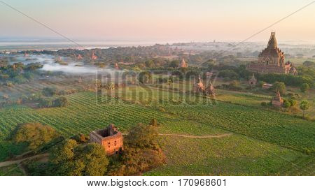 Aerial view of ancient pagodas in the plain of Bagan at sunrise, Myanmar