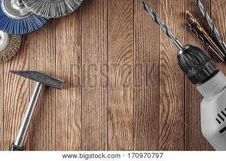 Workplace On A Wooden Table With Drill Bit, Tools, Grinding Discs