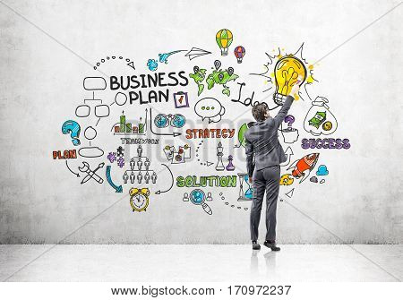 Man Drawing Colorful Business Plan Sketch