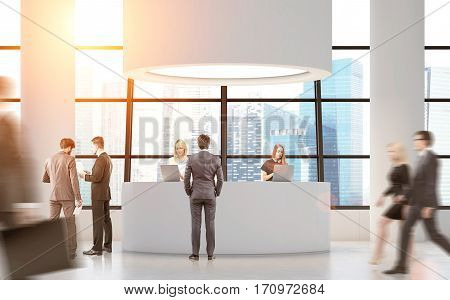 Rear view of people near a round reception desk with columns by its sides. 3d rendering. Toned image. Mock up.