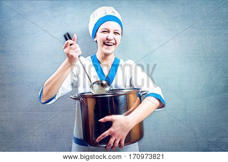 Portrait of beautiful female chef on background.