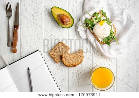 sandwich with poached eggs on wooden background top view mockup.
