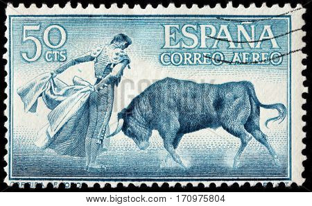 LUGA RUSSIA - FEBRUARY 7 2017: A stamp printed by SPAIN shows beautiful scene of Spanish-style bullfighting circa 1960