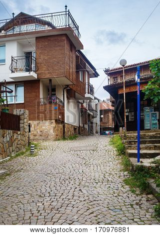 Sozopol Bulgaria - September 06 2014: Old town of Sozopol at Black Sea Bulgaria. Street ancient architecture and cobbled stone pavement. Architectural and Historic Complex. Vertical shot.