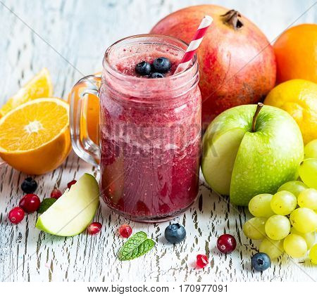 Red berry and fruit smoothie healthy juicy vitamin drink diet or vegan food concept fresh vitamins homemade refreshing fruit beverage