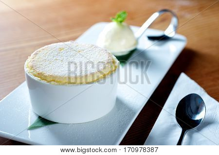 Delicious Custard dessert on plate with ice cream