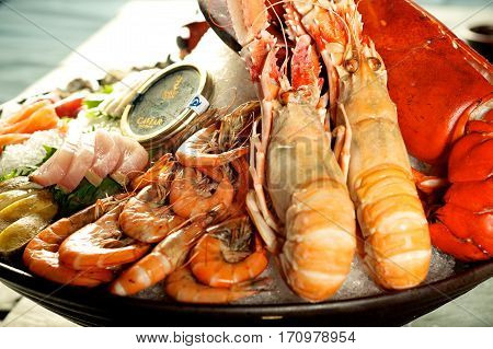 Delicious Seafood platter with tasty giant lobster