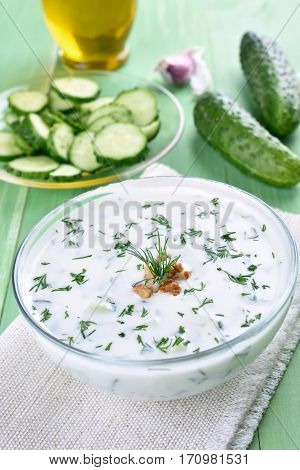 Cold summer soup with yoghurt cucumbers dill and walnut