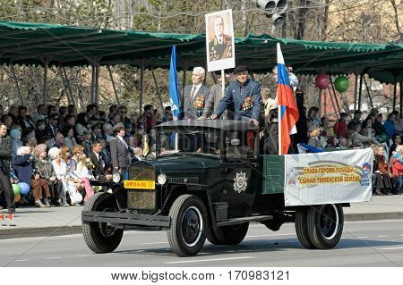 Tyumen, Russia - May 9. 2006: Parade of Victory Day in Tyumen. Truck with veterans of Great Patriotic War on parade