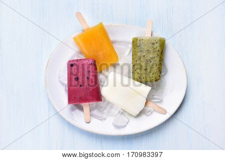 Popsicles icecream from fruits on plate top view