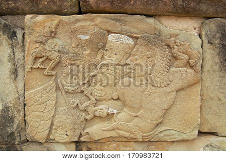 SIEM REAP, CAMBODIA - AUGUST 10, 2008: Exterior of the ancient bas-relief at the wall of the Bakong temple in Siem Reap, Cambodia.