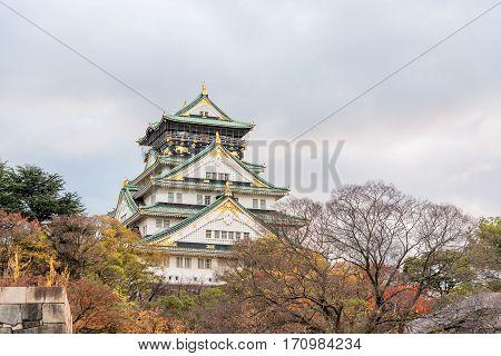 Osaka Castle with autumn leaves Osaka prefecture Japan UNESCO world heritage site.