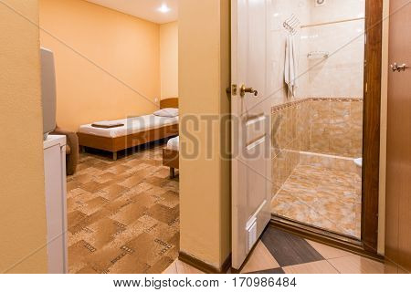 The Interior Of The Small Room, The Entrance To The Room And Bathroom