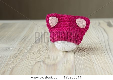 Knitted crochet small pink hat. Women's hat for the feminists march protest. Creative craft work