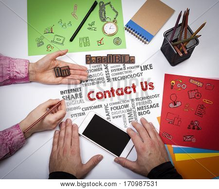 Contact Us, Customer Support Concept. The meeting at the white office table.