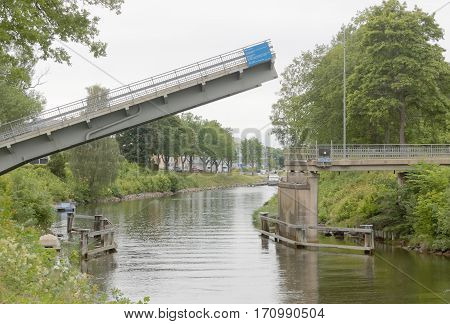 Bridge opening in a narrow canal to let boats pass