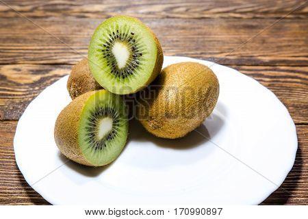 Kiwi On A Wooden Table.