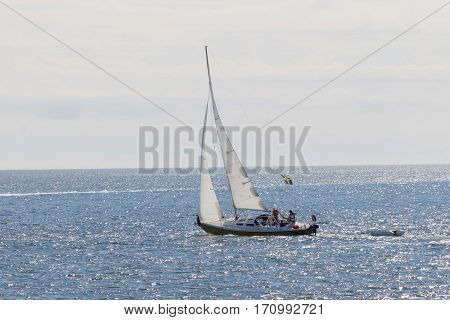 Sailboat on the glittering blue sea a summar day