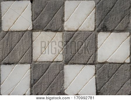 Chequered gray and white stone texture, background image.