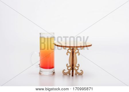 Alcohol Cocktail In Glass On Little Decorative Table