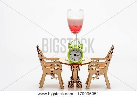 Alcohol Coctail Singapore Sling On Decorative Table With Chairs, Clock