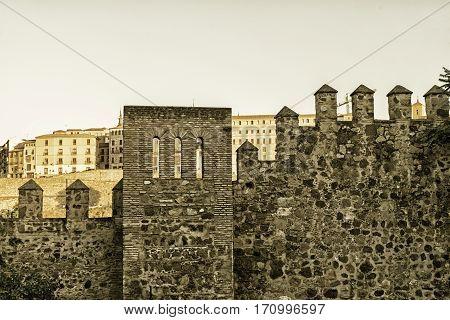 Toledo (Castilla-La Mancha Spain): the medieval walls at evening. Sepia
