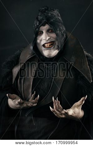 Happy Crazy Smiling Vampire With Large Scary Nails. Undead Monster