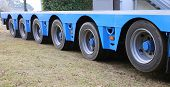very long truck trailer for exceptional transport with many sturdy tires poster