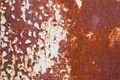 Corroded white metal background. Rusted white painted metal wall. Rusty metal background with streaks of rust. Rust stains. The metal surface rusted spots. Rusty corrosion. poster