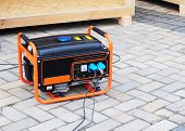Gasoline Portable Generator on the House Construction Site. Close up on Mobile Backup Generator. Standby Generator - Outdoor Power Equipment. poster