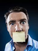 caucasian man surprised mouth shut by note paper portrait isolated studio on black background poster