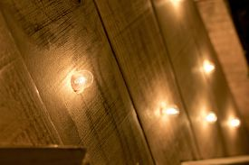 Small lights turned on on a wooden surface.