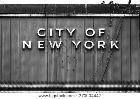 Black And White Image Of The Words City Of New York Written Old Old Metal Fence Surface