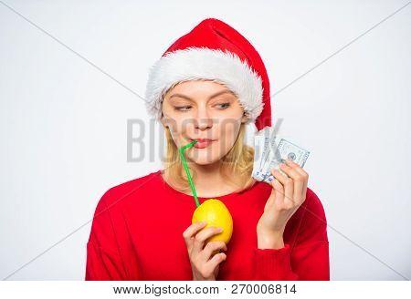 Rich Girl With Lemon And Money. Lemon Money Concept. Girl Santa Hat Drink Juice Lemon While Hold Pil