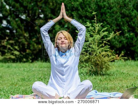 Clear Your Mind. Girl Meditate On Rug Green Grass Meadow Nature Background. Woman Relaxing Practicin