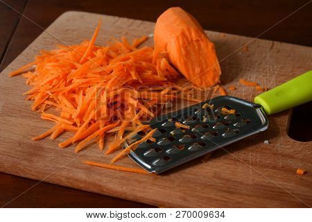 Woman Cook Sauerkraut Or Cabbage Salad On Wooden Background. Step 2 - Grated Carrots. Fermented Pres