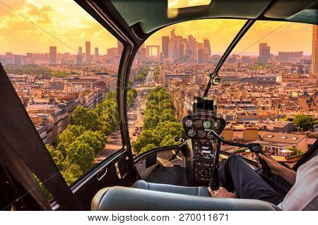 Helicopter Cockpit Flying On Charles De Gaulle Square In Paris, French Capital, Europe. Scenic Fligh