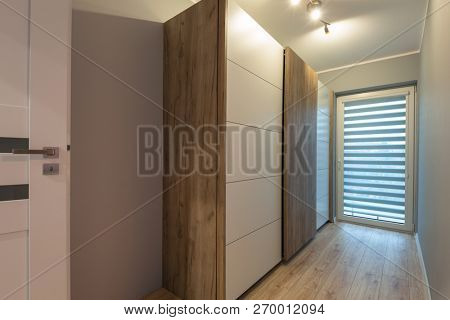 Interior of a modern house with wooden wardrobe