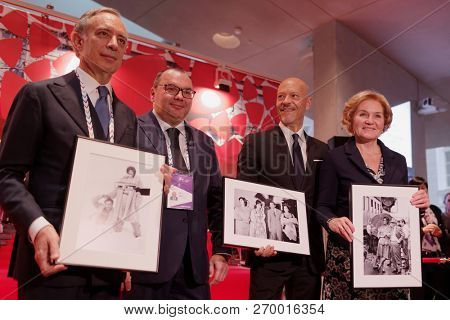 ST. PETERSBURG, RUSSIA - NOVEMBER 15, 2018: Left to right - Pasquale Terracciano, Sergey Mikhailov, Fyodor Bondarchuk, and Olga Golodets on the opening of photo exhibition during SPb Cultural Forum