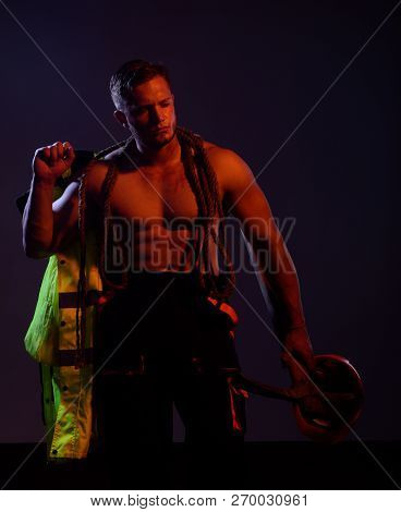Remain Under Construction. Man Miner With Mining Equipment. Hard Worker With Muscular Torso. Muscula