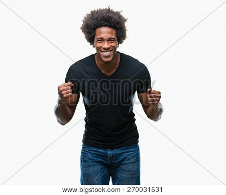 Afro american man over isolated background very happy and excited doing winner gesture with arms raised, smiling and screaming for success. Celebration concept.